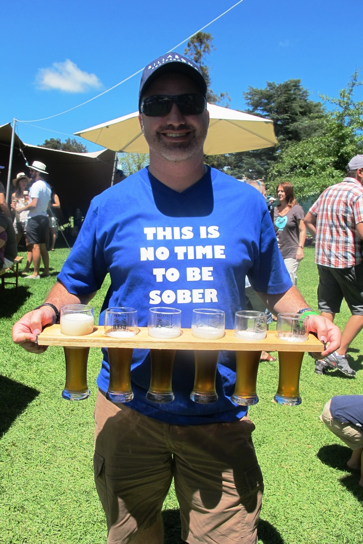 This guy and his friends are the best-prepared beerfest-goers I've ever seen, equipped not only with matching t-shirts but also a beer-carrying plank for easy bulk purchases